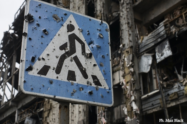 In this photo taken on Sunday, Oct. 25, 2015, a road sign pierced by shrapnel stands at a new terminal of Donetsk Airport destroyed by shelling, in Donetsk, eastern Ukraine. The fighting has subsided, but Donetsk is quickly sinking into the past, a shabby Soviet-like state of empty streets and deprivation. Huge portraits of Josef Stalin hanging in the city center only reinforce the impression of failure. (AP Photo/Max Black)